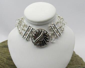 Triple row chain bracelet with sun toggle
