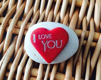 """Handmade Red glitter clay heart inscribed """"I love You"""" mounted on a white pebble"""