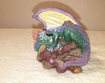 Green and purple dragon with purple wings