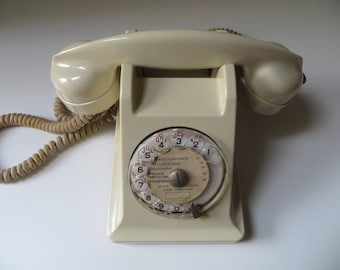 Vintage French rotary phone of the forties -   white bakelite model 1943