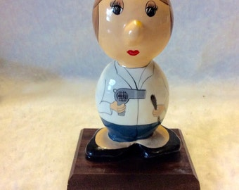 Hand painted hand made woman with hairdryer sculpture paperweight. Signed.