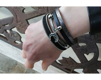 Leather bracelet with silver charms.