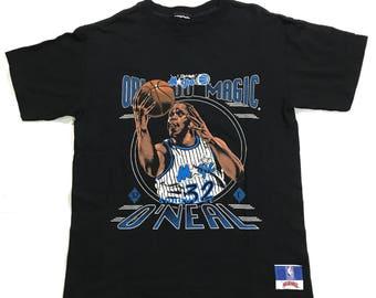 Vintage 90s Orlando Magic Shaq T Shirt by nutmeg Tag is ripped fits like S, shaq t shirt, vintage orlando shaq shirt, orlando magic shirt