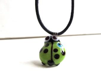 Green Ladybug Evil Eye Pendant