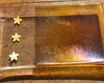 Special silver and gold iridescent shiny plate with real silver flowers reacting with the glass and appearing gold