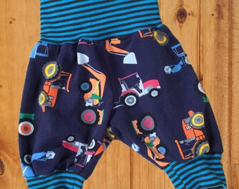 Baby harems, colourful construction fabric with striped jersey waistband and ankles. Tractors, diggers. Navy background. 0/3months