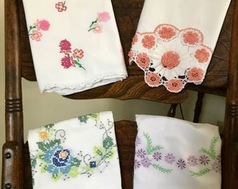 Embroidered Pillow Cases. Vintage material , Good condition . Cotton and blend material .