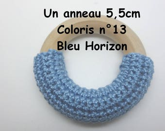 A semi ring covered in crochet