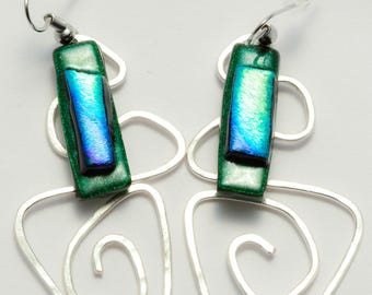 Beautiful earrings of dark green, irridescent glass with a blue/green/gold dichroic with hammered silver, geometric wire accents! Elegant!