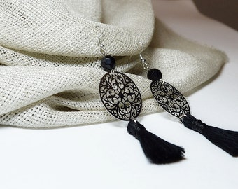 Silver filigree with black beads and black cotton tassels