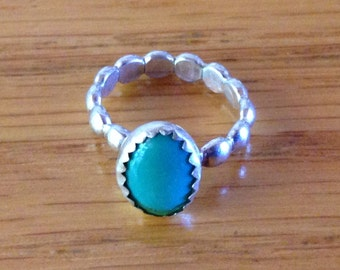 Sterling Silver Child's Ring with Green Gemstone, approx. size 1 or 2