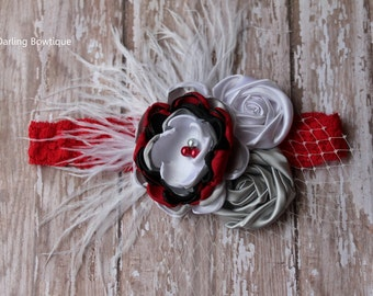 Red Silver White and Black Rosette and Singed Flower with Feathers on Red Lace Headband