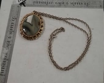 Vintage used goldtoned pendant  silvertone necklacewith stone and mirror