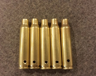 "Drilled empty brass casings, pre-drilled to approx. 3/32"" diameter"