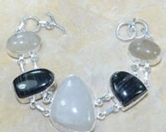 Moonstone, black zebra jasper, and rutilated quarts bracelet