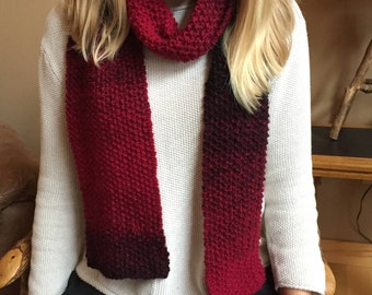 Knitted cranberry/black scarf, 7 x 70 inches, 88 per cent acrylic, 22% wool