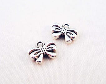 BNE24 - 2 bow tie sterling silver Tibetan charms