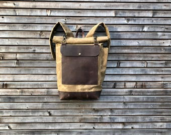 Waxed canvas backpack / rucksack with roll to close top and padded shoulder straps