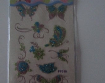 temporary tattoos (Tattoos) with butterflies and flowers - sequins clutch