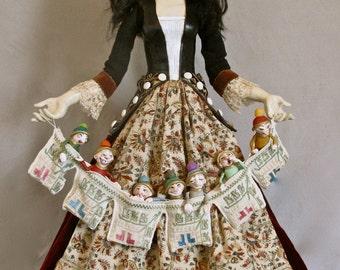 Snow White, porcelain art doll holding the Seven Dwarves