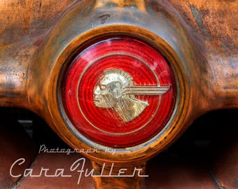 Pontiac Emblem on the bumper of a Rusty Car Photograph