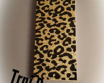 Gold and Black notepad