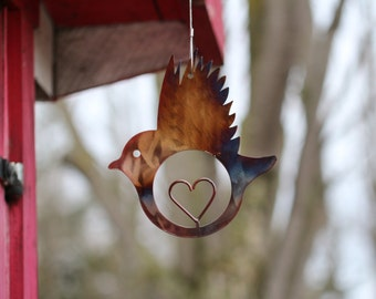 Hand forged wrought iron bird with heart cutout