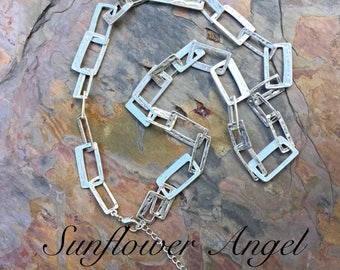 Abstract, long style rectangle hammered chain link necklace. In mat and polished silver.