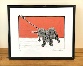 Basset hound on red linocut