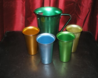 "Atomic Aluminum Drink Set ""Zephyr"" Brand Set Includes 4 Aluminum Tumblers and Emerald Green Pitcher."
