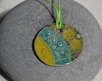 Ceramic patterned and glazed pendant: handmade, light and dark green, turquoise
