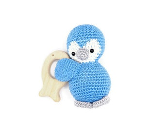 Rattle with crocheted penguin