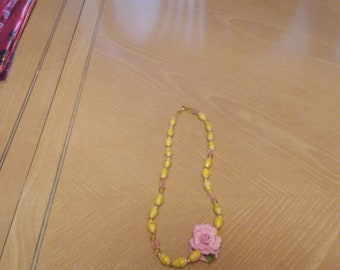 Necklace Beads and rose blossom.
