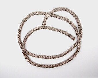 Woven beige polyester cord