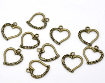 4 charms/pendants heart carved metal bronze