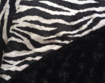 Sale, I took 10 dollars off this Tween/teen/toddler blanket with a zebra print shannon brand cuddle a black swirl/rosebud .
