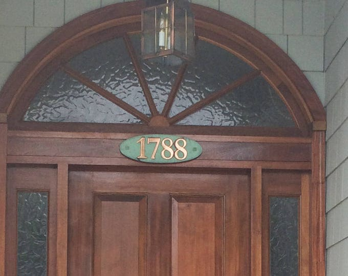 """Oval House number plaque in patinated copper, 1 - 5 nos.  3""""/75mm, 4""""/100mm high in Garamond with plywood back g"""