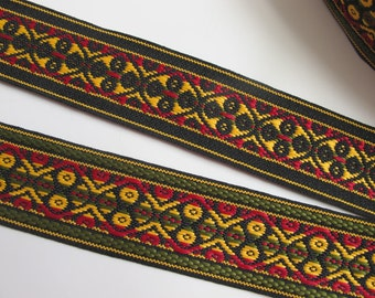 FOUR WHEELS, 3 yards reversible Jacquard strap in red, yellow, green on black. 1 3/8 inch wide. 975-A