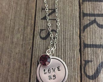 Stamped metal necklace with charm. Can customize to you.
