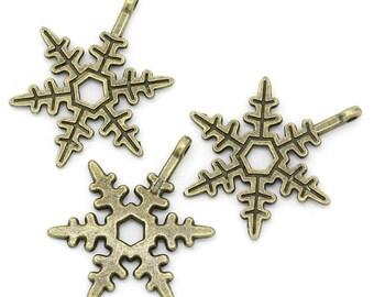 6 metal snowflake charms bronze