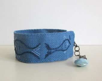 Textile bracelet, fabric jewelry, hand embroidered, textile cuff, fish design, blue jewellery, boho chic