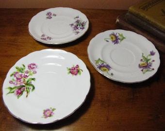 Three (3) Vintage Saucers - Floral Patterns