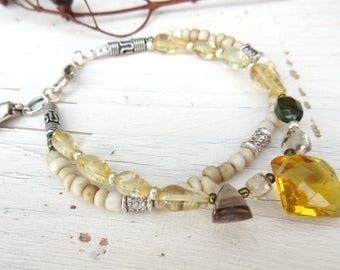 Space Of Liberty: a romantic bracelet, poetic 2 rows with citrine, smoky quartz; silver beads Bali ....