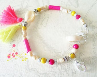Cowrie shells, bone bead and tassel pink and yellow bracelet