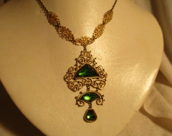 Antique filigree necklace with emerald green stones