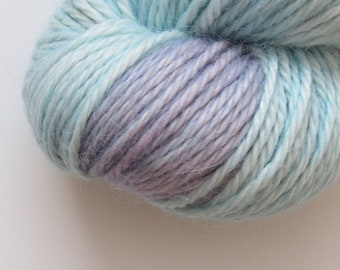 Alpaca and silk Aran weight hand dyed knitting yarn in turquoise and purple