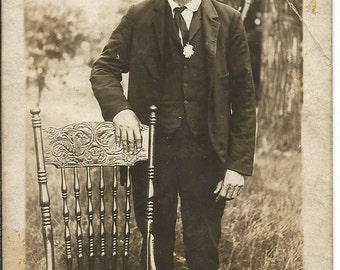 Vintage 1900's Photograph Postcard of Man Standing by Chair