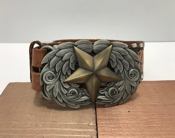 Vintage handtooled brown leather hand leather laced western belt with bronze and silver star buckle