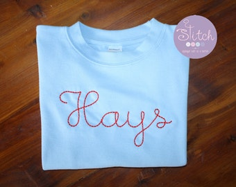 Sky Blue Long Sleeve Crew Neck Tee with Name in Red Floss Stitch