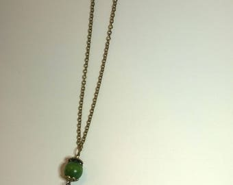Antique gold long chain necklace with green wooden beads